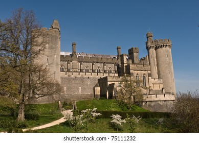 View of Arundel castle in Sussex, from the gardens showing the towers and battlements. The castle established in 1068 is home to the Duke and Duchess of Norfolk.