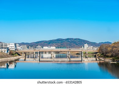 View of  Asahi River with Okayama cityscape background.