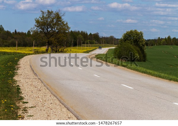View to the asfalt country road with car.