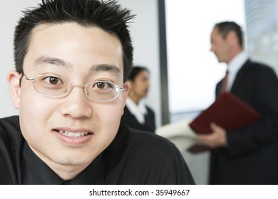 View of an Asian businessman with colleagues.