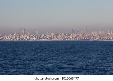 A view to Asian part of Istanbul from Marmara Sea. Evening time. Industrial mist above the city.Text-space. Outdoor shot