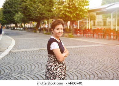View of asian woman enjoy surroundings near Sinan Pasha Mosque that was declared a Monument of Culture of Exceptional Importance in 1990 by the Republic of Serbia. Prizren Kosovo.