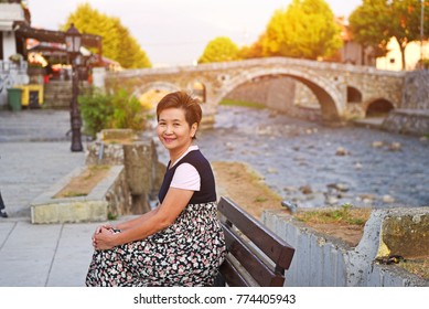View of asian woman enjoy surroundings near Sinan Pasha Mosque that was declared a Monument of Culture of Exceptional Importance in 1990 by the Republic of Serbia - Prizren Kosovo