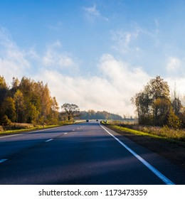 A view of the asphalt country road in Latvia on a clear autumn day, Latvia