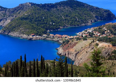View of Assos village and beautiful sea bay, Kefalonia island, Greece. The traditional architecture, the peaceful landscape and the pebbled beaches compose the natural beauty of Assos.