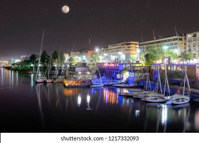 View of Aswan at night with full moon in starry sky