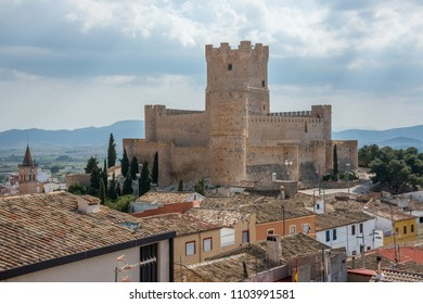 View of the Atalaya castle, enter the houses of a neighborhood of Villena, Community of Valencia, Spain