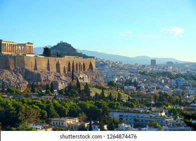 View of Athens with Acropolis and Lycabettus Hill on a sunny day