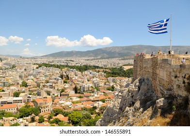 View of Athens, Greece from the Acropolis with Greek flag in the background