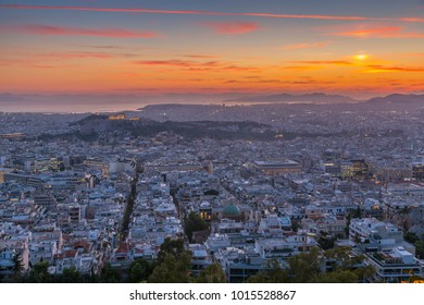 View of Athens from Likavitos Hill and Aegean Sea visible on horizon at sunset, Athens, Greece, Europe 12 October 2017