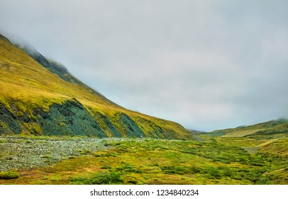 A view of the Atigun Pass in The Brooks Range on the Dalton Highway in Alaska, USA. Here the Dalton Highway crosses the Continental Divide.