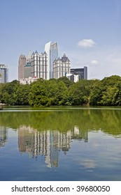 A view of the Atlanta Skyline shot from Piedmont Park with reflections in lake