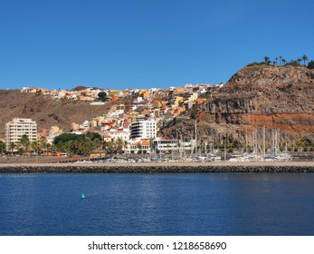 """view from the Atlantic on """"San Sebastian de Gomera"""" Dark blue sky and azure Atlantic, with the colorful cube houses nestled in the slope, an idyll"""