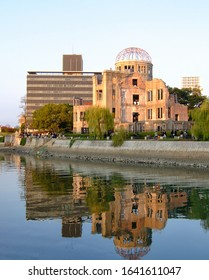 The view of the Atomic Bomb Dome, the former Hiroshima Prefectural Industrial Promotion Hall on the rivershore of Ota river at the sunset. Hiroshima. Japan