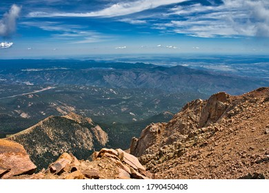 View from atop Pikes peak overlooking the surrounding colorado countryside. Fourteener seeing for miles