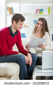 View of an Attractive couple doing administrative paperwork. Selective focus
