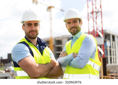 View of an attractive worker and an architect on a construction site