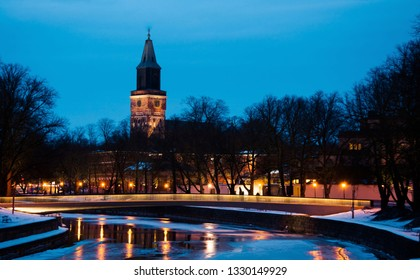View of Aura river at night with Turku Cathedral in background