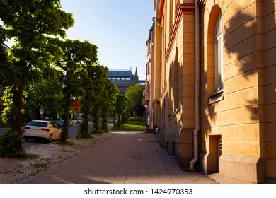 View of Aurakatu street and the historical building of the art museum built in 1904 on Puolalanmaki Hill in the city of Turku in Finland. Summer in Turku in Finland.