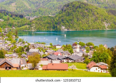 View of austrian alpine town St. Gilgen and Wolfgangsee lake, Salzburg, Austria. Beautiful spring day in mountains.