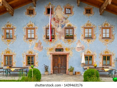 View of Austrian flag and colourful architecture in St. Johann in Tirol Austrian Tyrol, Austria, Europe 1-5-2019