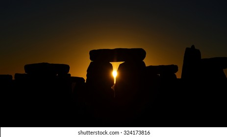 View of the Autumn Equinox Sunrise at against the Silhouette of the Standing Stones at Stonehenge in England