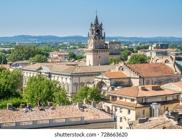 View of Avignon city from roof top of Papal palace (Palais des Papes) under clear blue sky in Avignon, France