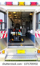 View of the back of an ambulance with the doors open.