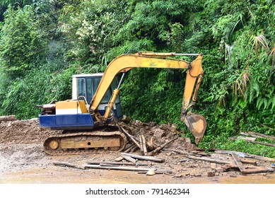 View of backhoe was digging a pit in the ground for rainwater,Crawler excavator truck ,Construction digger machine in flat. Backhoe loader, Heavy equipment. Backhoe working at construction side.