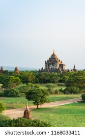View of Bagan city when sunrise with Buddhist temples and stupas in green field, Bagan - Myanmar
