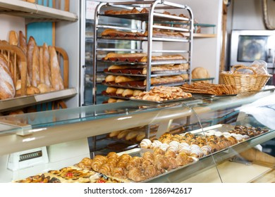 View of bakery glass display full of various appetizing confectioneries