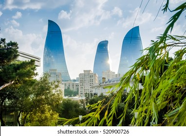 View of the Baku towers from local park. Popular tourism location with towers like Flame, Azerbaijan Flame Towers, Baku Azerbaijan. Image of Azerbaijan Towers. Azerbaijan Flame concept background