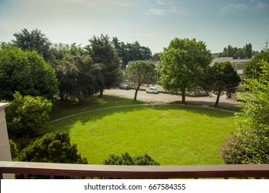 View from balcony to lawn and trees