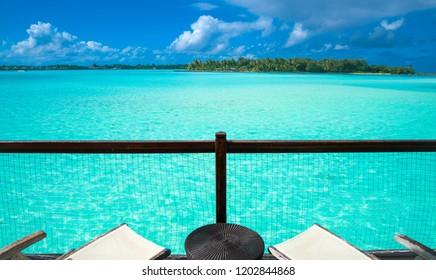 A view from a balcony of over the water bungalow in Bora Bora, Tahiti