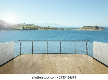 View from the balcony to the sea.Landscape. Sunny Day. Terrace with a beautiful view. Background with beautiful landscape. City near the sea.