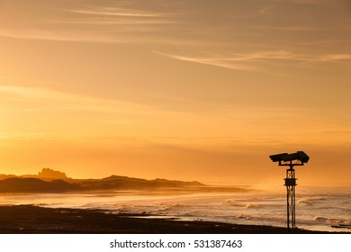 View of the  Bamburgh castle in a spectacular sunset from the Seahouses,Great Britain