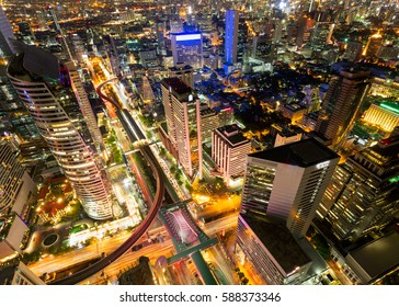 View of Bangkok modern office buildings, condominium in Bangkok city downtown with sunset sky ,Bangkok is the most populated city in Southeast Asia.BTS is an important infrastructure.