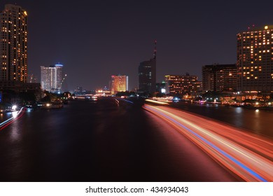 View of Bangkok in nighttime with speed light on the river