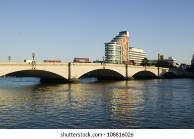 View from the banks of the River Thames at Fulham of Putney Bridge.  London.