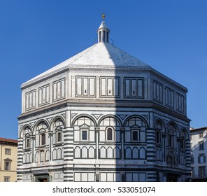 View of the Baptistery in the Piazza Santa Maria del Fiore in Florence, half-illuminated by the sun