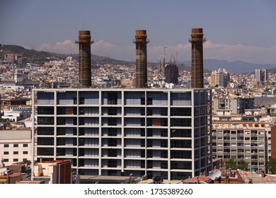 View of Barcelona city in Spain with three chimneys and Sagrada Famiglia