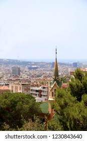 View of Barcelona from Park Güell with The Gaudi House Museum in the foreground.