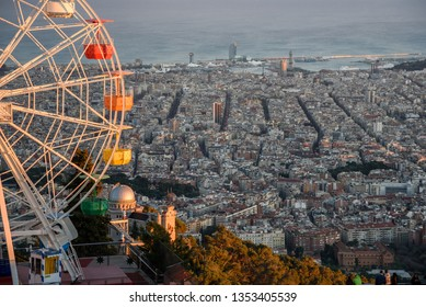 View of Barcelona from Tibidabo with a Ferris wheel in the foreground
