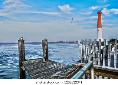 View of Barnegat light from the docks at Barnegat Bay a small brackish arm of the Atlantic Ocean, approximately 42 miles long, along the coast of Ocean County, New Jersey in the United States.
