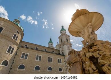 View of Baroque Fountain and Salzburg Cathedral in Residenzplatz, Salzburg, Austria, Europe 1-6-2019