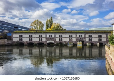 View of Barrage Vauban (Vauban Dam). The Barrage Vauban - bridge, weir and defensive work erected in the XVII century on the River Ill in the city of Strasbourg. Alsace, France.