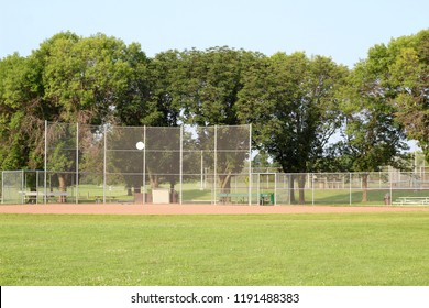 A view of the baseball field diamond from the outfield grass on a warm summertime day.