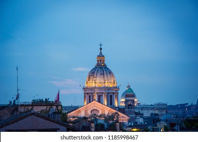 View of the Basilica of Saints Ambrose and Charles the Corso, Rome at Blue hour, sunset time.