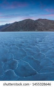 View of the Basins salt flats, Badwater Basin, Death Valley, Inyo County, California, United States. Salt Badwater Formations in Death Valley National Park. Wonderful sunset. Bucket list for roadtrip.