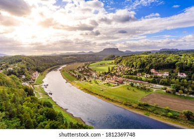 View from the bastei viewpoint of the Elbe river and the Rathen town in beautiful landscape scenery, Sandstone mountains, Saxon Switzerland National Park, Germany